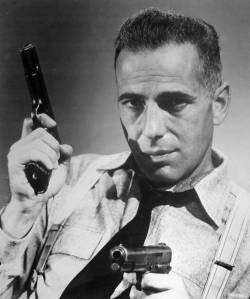 I can't help but imagine Vimes played by Bogart...